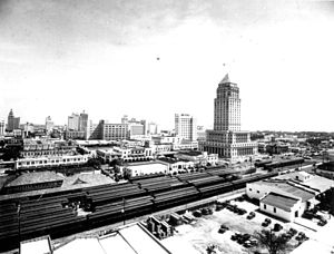 Greater Downtown Miami - Downtown skyline circa 1930s, with the Florida East Coast Railway passenger train station and the Dade County Courthouse in the foreground