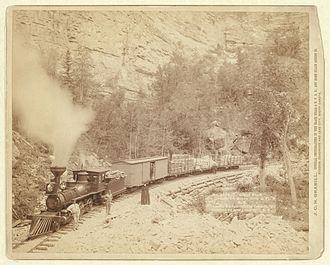 Black Hills and Fort Pierre Railroad - Train on the Black Hills and Fort Pierre Railroad through Elk Canyon in 1890.