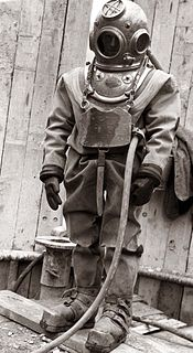 Standard diving dress Rubberised canvas diving suit with copper helmet and weighted boots