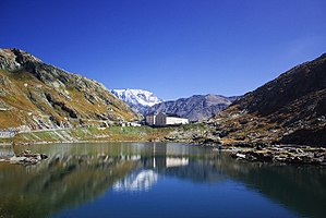 Great St Bernard Pass - View of the pass and hospice from Great St Bernard Lake