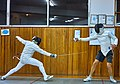 Greek Epee Fencers. Evening training at Athenaikos Fencing Club with fencers from other clubs. On the right Aris Koutsouflakis.jpg