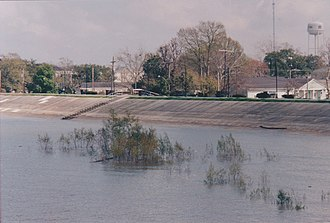 Levee - A levee keeps high water on the Mississippi River from flooding Gretna, Louisiana, in March 2005.