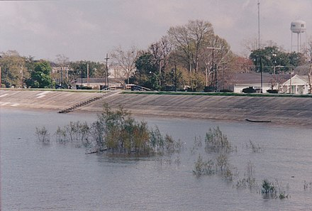 A levee keeps high water on the Mississippi River from flooding Gretna, Louisiana, in March 2005. GretnaLevee.jpg