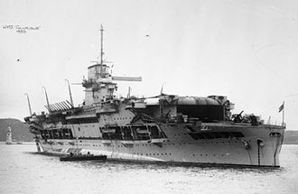 HMS Glorious - Glorious at anchor, 1935; the doors to the lower hangar deck are open