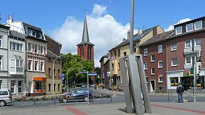 Haaren (Aachen) - Center of Haaren, showing St. Germanus Church and sculpture by Joachim Bandau
