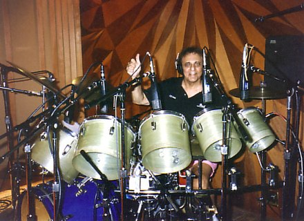 "Session musician Hal Blaine (pictured in 1995) is widely regarded as one of the most prolific drummers in rock and roll history, having ""certainly played on more hit records than any drummer in the rock era"". Hal Blaine in 2008.jpg"