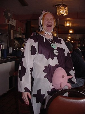 A woman wearing a cow Halloween costume.