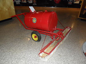 Ice resurfacer - Prior to the invention of mechanized ice resurfacers, hand flooders such as this one were pulled around the rink laying an even layer of hot water. This flooder is in the collection of the International Hockey Hall of Fame