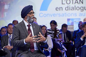 Harjit Sajjan - Sajjan speaking at the Brussels Summit Dialogue in 2018