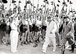 Benito Mussolini being cheered by Fascist Blackshirt youth in 1935