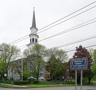 Herkimer (village), New York - Reformed Church and Historic Four Corners sign at North Main Street and Church Street