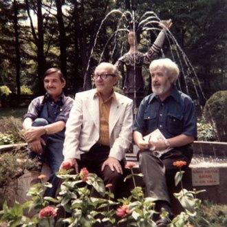 "Soyuzivka - Ukrainian artists Liuboslav Hutsaliuk, Edward Kozak and Jacques Hnizdovsky in front of Slava Gerulak's ""Mayana"" fountain at Soyuzivka"