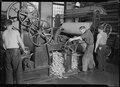 Holyoke, Massachusetts - Paper. American Writing Paper Co. Rewinding paper from reel. - NARA - 518327.tif