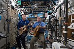 ISS-55 Drew Feustel and Scott Tingle play guitar inside the Destiny lab.jpg