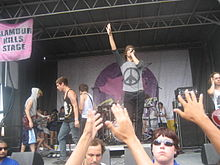 I See Stars performing at the Vans Warped Tour in 2010. From left to right: Jimmy Gregerson (former), Zach Johnson (former), Jeff Valentine, Devin Oliver, Andrew Oliver (behind), Brent Allen.