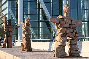 Toronto Pearson International Airport - Inuksuk sculptures stand in front of the departures entrance at Terminal 1.