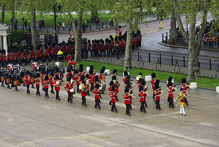 Band of the Irish Guards marching into Wellington Barracks following the Queen's Birthday Parade in 2017 Irish Guards Band State Opening of Parliament 2012.jpg