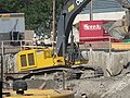It takes this backhoe five buckets to load one of it dump trucks, 2015 09 23 (7).JPG - panoramio.jpg