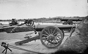 James rifle - Two Model 1829 32-pounder siege and garrison guns rifled using the James method.  The one in the foreground is on a siege carriage.  The one behind is on an iron, front pintle, barbette carriage.