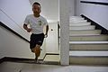 Japan Maritime Self-Defense Force Naval Aircrew Chief Select Kim Sato climbs the stairs of a tower at Naval Air Facility Atsugi, Japan, Sept 120911-N-TO330-0301.jpg