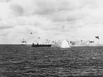 USS Belleau Wood (CVL-24) - A Japanese bomber explodes as it crashes into the sea near Belleau Wood, during an attack on Task Group 58.2 off the Mariana Islands, 23 February 1944.