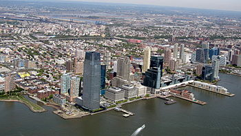 Aerial view with Exchange Place and Newport neighborhoods of Downtown Jersey City in foreground
