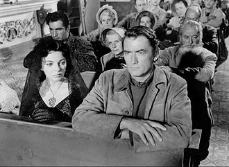 The Bravados - Joan Collins and Gregory Peck in a scene from the film.