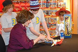 Toy Story 3 - Joan Cusack, who voiced Jessie in the film, signing Toy Story 3 merchandise.