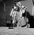 Joodse man met een hoedje op en een gebedsmantel om bezig met het aanleggen van , Bestanddeelnr 255-4707.jpg