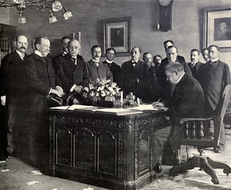 Resolute desk - Jules Cambon, the French Ambassador to the United States, signing the memorandum of ratification on behalf of Spain in 1899.