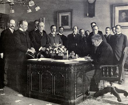 Signing of the Treaty of Paris Jules Cambon signs Treaty of Paris, 1899.JPG