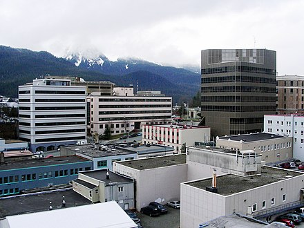 "The center of state government in Juneau. The large buildings in the background are, from left to right: the Court Plaza Building (known colloquially as the ""Spam Can""), the State Office Building (behind), the Alaska Office Building, the John H. Dimond State Courthouse, and the Alaska State Capitol. Many of the smaller buildings in the foreground are also occupied by state government agencies. Juneau, Alaska Downtown.jpg"
