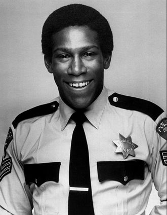 Kene Holliday - Holliday as Curtis Baker in Carter Country in 1977