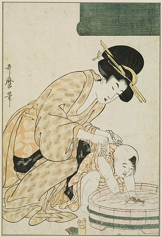 Kitagawa Utamaro - Mother Holding Child as He Plays with a Toy Fish in a Tub of Water - MFA Boston 11.22154.jpg