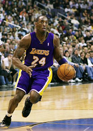 Kobe Bryant of the Los Angeles Lakers drives t...
