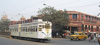 Entally - A tram rolls past Entally Market