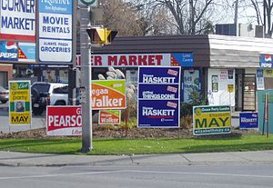 By-elections to the 39th Canadian Parliament - Lawn signs for all the major candidates decorate an intersection during the by-election