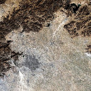 Geography of Beijing - Satellite image of Beijing Municipality, showing the city of Beijing (in pink) with mountains in the north and west and plains to the east and south