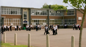 School - School building and recreation area in England