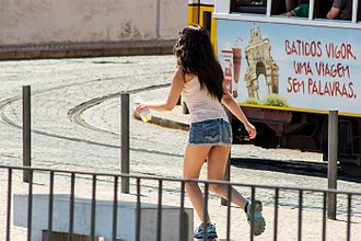 Modesty - The definition of modest clothing varies vastly between cultures. The photograph shows a girl in a  microskirt in Portugal.
