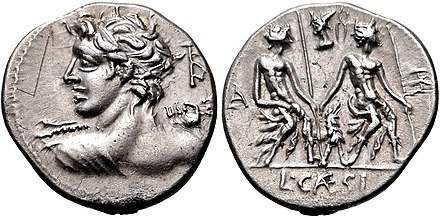 Denarius of Lucius Caesius, 112-111 BC. On the obverse is Apollo, as written on the monogram behind his head, who also wears the attributes of Vejovis, an obscure deity. The obverse depicts a group of statues representing the Lares Praestites, which was described by Ovid. Lucius Caesius, denarius, 112 BC, RRC 298-1.jpg