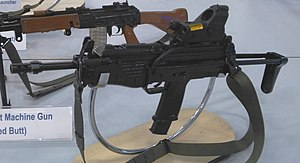 Modern Sub Machine Carbine - A MSMC submachine gun on display. The weapon has a red dot sight on the upper receiver.