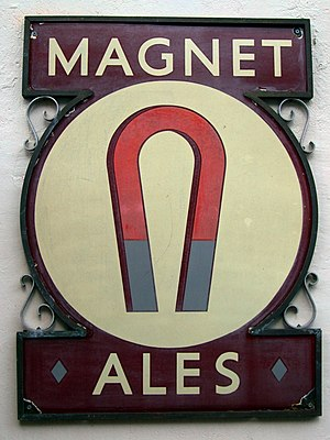 "John Smith's Brewery - A sign on a pub in London advertises ""Magnet Ales"""