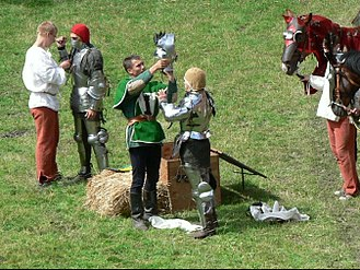 Squire - A squire helping his knight, in a historical reenactment in 2009