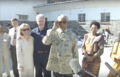 Mandela speaks to media after presenting Clinton's with quarried rock B.png