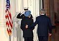 Manmohan Singh is escorted by the US President, Mr. George Bush at a dinner hosted by him in White House in connection with the Summit on Financial Market and the World Economy, at Washington, USA on November 14, 2008.jpg