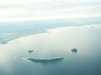 Tunku Abdul Rahman National Park - An aerial view of Mamutik (top left), Sulug (top right) and Manukan (bottom) resembling a smiling face.