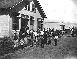 Manzanar - Manzanar Community Hall, ca. 1912. In back is Hatfield's (later Bandhauer's) General Store, which housed the post office