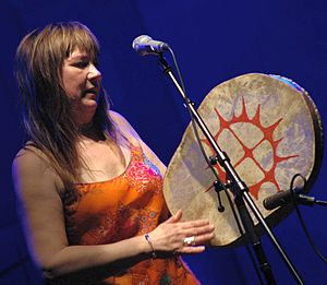 Sami drum - Mari Boine with a modern drum. Drums are now used both as a musical instrument and as a symbol of Sami identity.