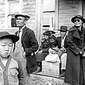 May 9, 1942 farm families wait for bus to Tanforan Assembly Center with 595 others from near Centerville CA., photo by Dorothea Lange (2), from- Japanese Americans in World War II, a National Historic Landmark theme study (page 1 crop).jpg